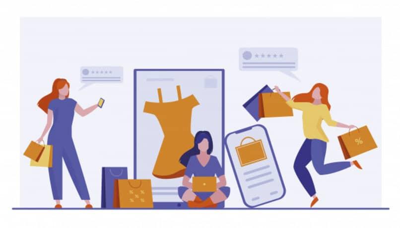 chicas comprando ropa mediante el uso de internet