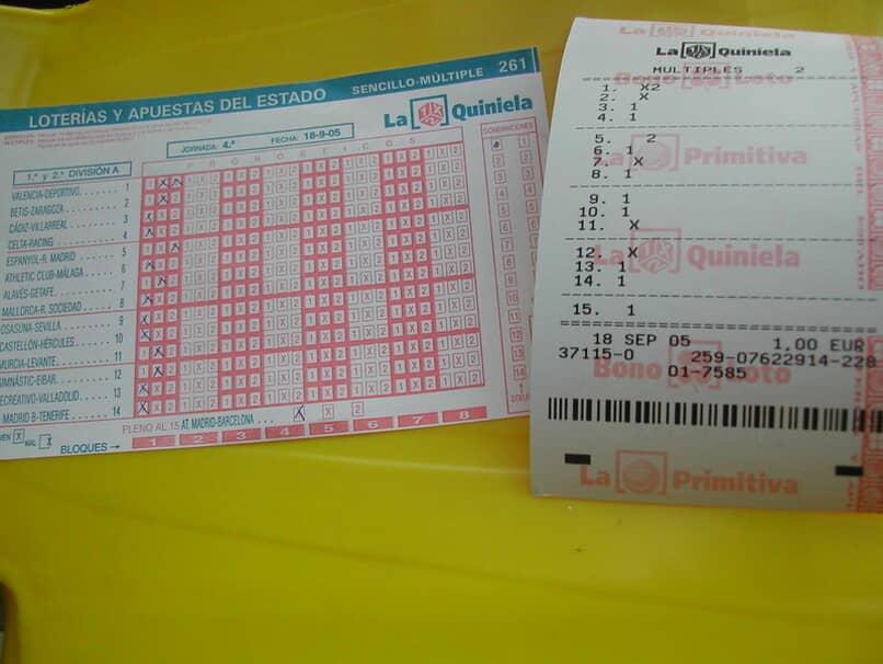 tabla y recibo de quinielas realizadas en loterias y apuestas del estado