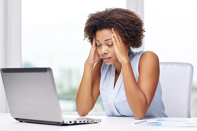 african woman with laptop at office