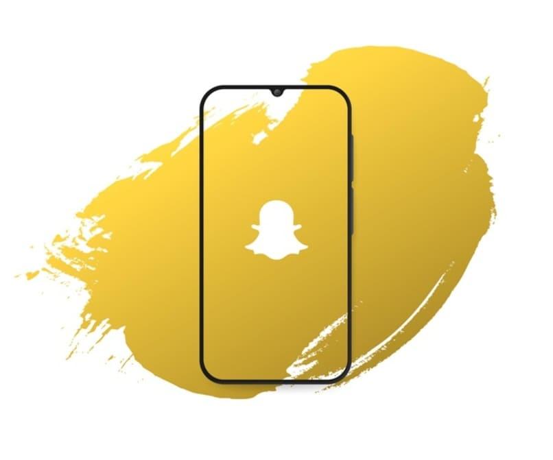 splash amarillo con logo de snapchat en el centro de un movil