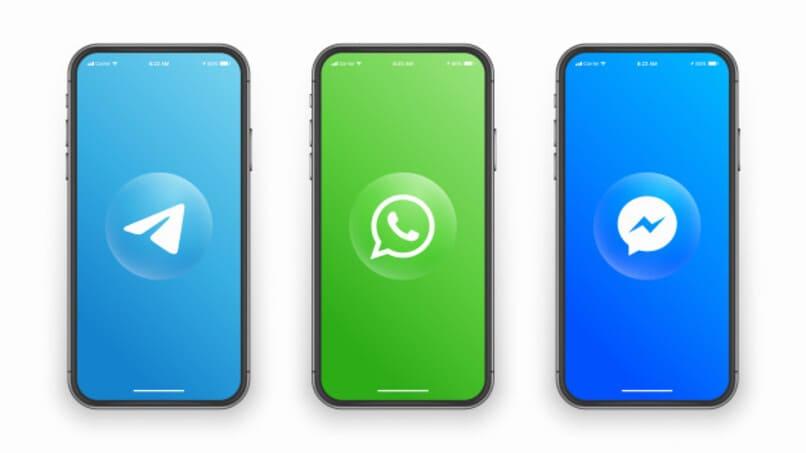 logos de app de mensajeria telegram whatsapp y messenger en pantalla de movil