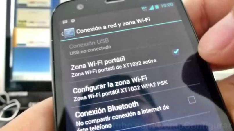 movil blu color oscuro sostenido ajustes conexion red zona wifi