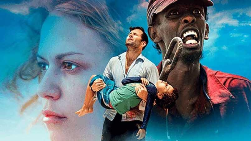 hombre cargando hijo
